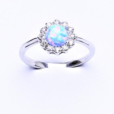 Stříbrný prsten, světle modrý syntetický opál, čiré zirkony, T 1495