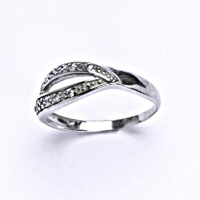 Stříbrný prsten s čirými zirkony , T 1416